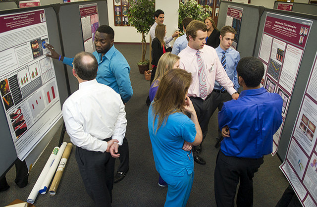 Students and residents share their posters with faculty and peers during the 2014 TAMBCD Research Scholars Day.