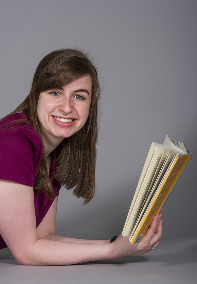 """Briana Bonney, first-year dental hygiene student, with the book """"Born to Run"""""""