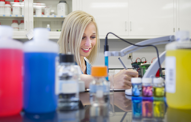 Second-year dental student Christina Barry, one of TAMBCD's predoctoral student research fellows, works in the lab.