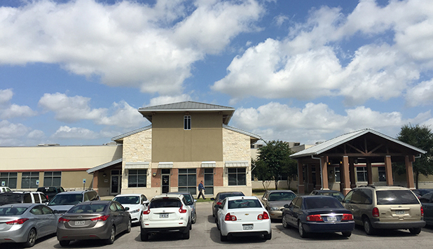 Cars fill the parking lot during a typical weekday at the Bastrop Community Health Center.