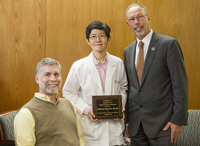Left to right: Dr. Douglas Benson, Dr. Yi-Shing Lisa Cheng, Dean Lawrence Wolinsky