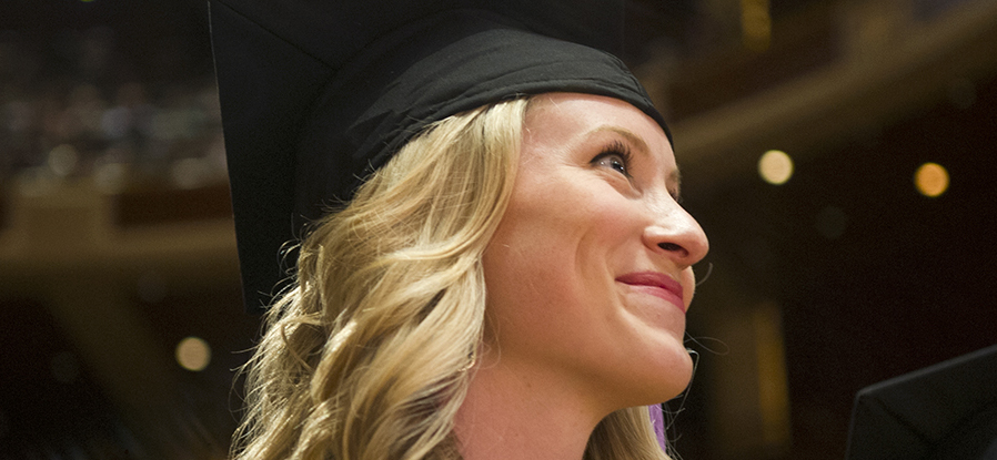 A student smiles during commencement exercises.