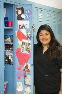 Photos of family members fill Dominique Salas-Garfias' locker at TAMBCD.