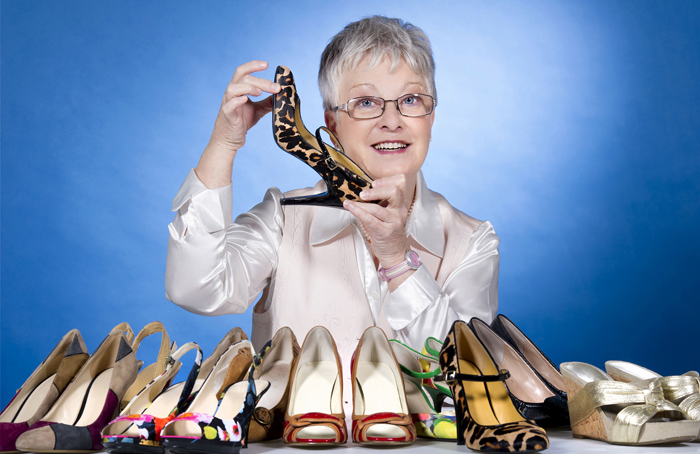 """Moira Allen's passion for footwear isn't exactly a secret. A mere glance in her office reveals some subtle giveaways: shoe stickers on her file cabinet, a tape dispenser shaped like a shoe and — during the holidays — a stocking hung on her office door with care, glittery heel and all. In all those years of wearing heels, Allen — whose late husband had to convert a linen closet just to store the collection — can't recall one mishap, stumble or fall. Her feet never get sore. And kitten heels; forget it. """"I don't like little teeny, tiny heels,"""" Allen says. """"But I wonderfully love a good pair of shoes."""""""