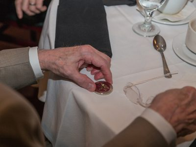 The Challenge Coin, like this one, above, is awarded each year during the Graduate Prosthodontics Annual Recognition Dinner.