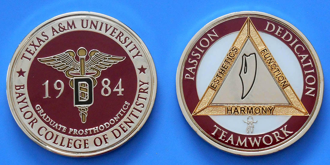 "The coin is customized to highlight the Graduate Prosthodontic program with Texas A&M colors. The reverse of the coin features a gold delta representing dentistry with the words ""function,"" ""esthetics"" and ""harmony"" on the three sides — the essence of prosthodontics. The delta surrounds a diagram of Posselt's envelope of motion and function. The words ""passion,"" ""dedication"" and ""teamwork"" line the outer edge of the coin. Below the delta, the program's ""cowboy tooth"" mascot is showcased."