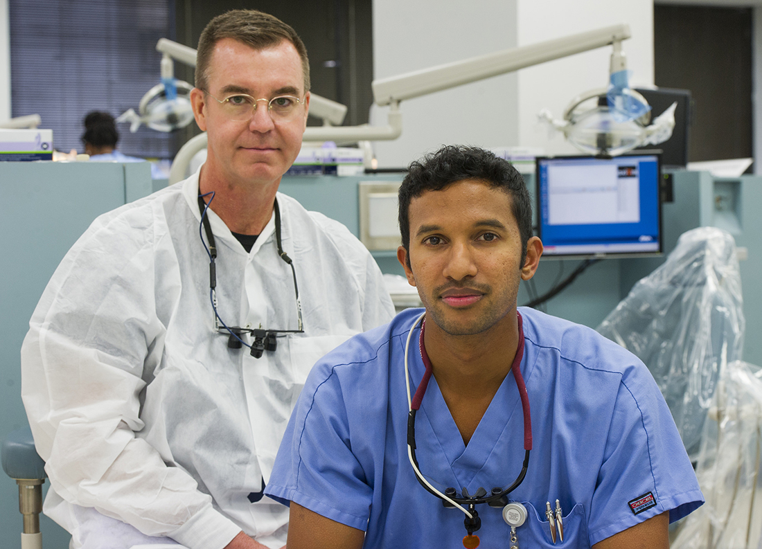 Shared responsibility: Dr. Brent Hutson (left) and dental student Keith Mahipala agree that dealing with diabetes begins the first time a patient steps foot in the clinic.