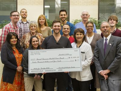 Texas A&M College of Dentistry dental students and area predental students presented a $12,000 check to college faculty, staff and administrators on Nov. 11.
