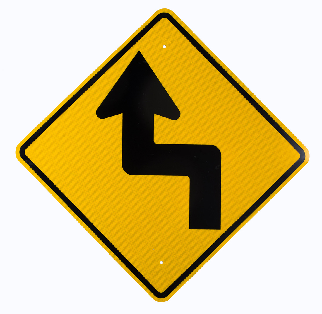 Street sign depicting a detour ahead
