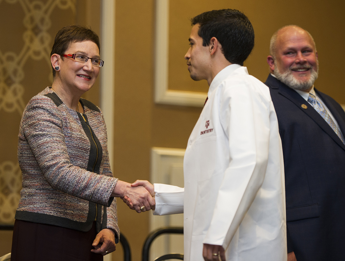 Dr. Carrie Byington greets a dental student during the Texas A&M College of Dentistry White Coat Ceremony on Feb. 3