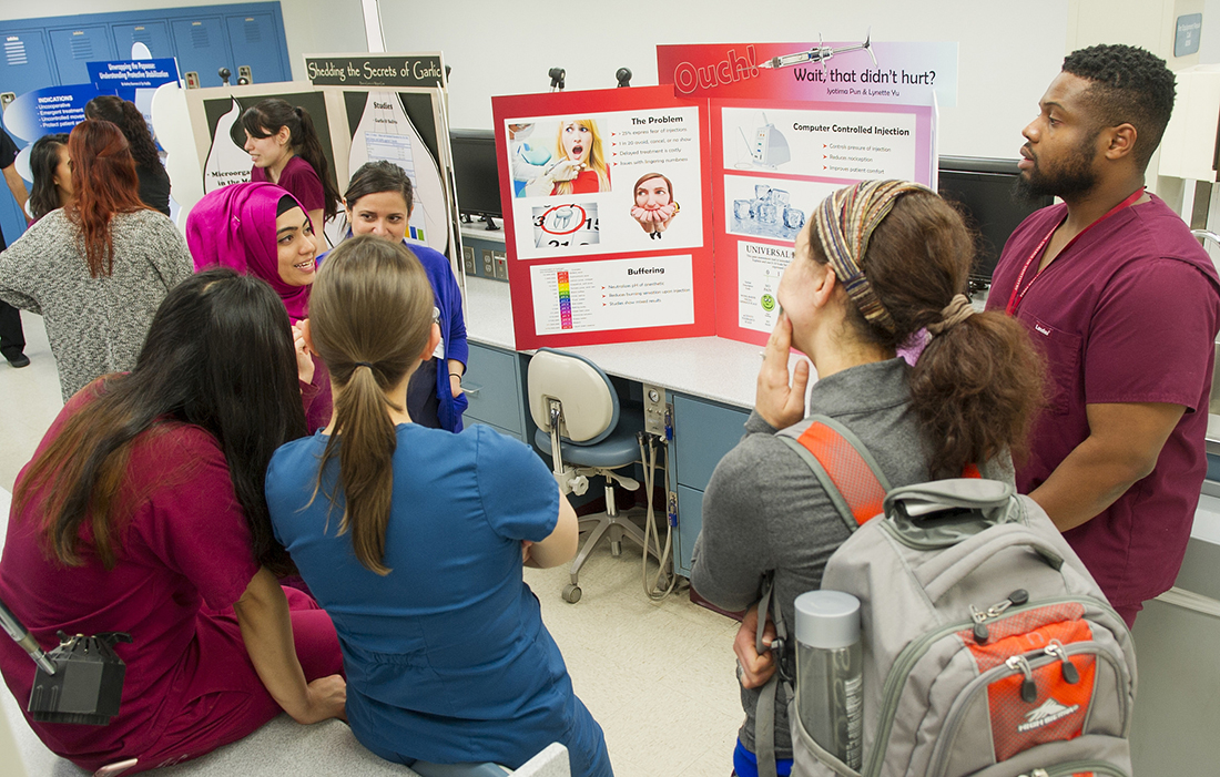 Dental hygiene students present their table clinic during the 2016 Research Scholars Day.