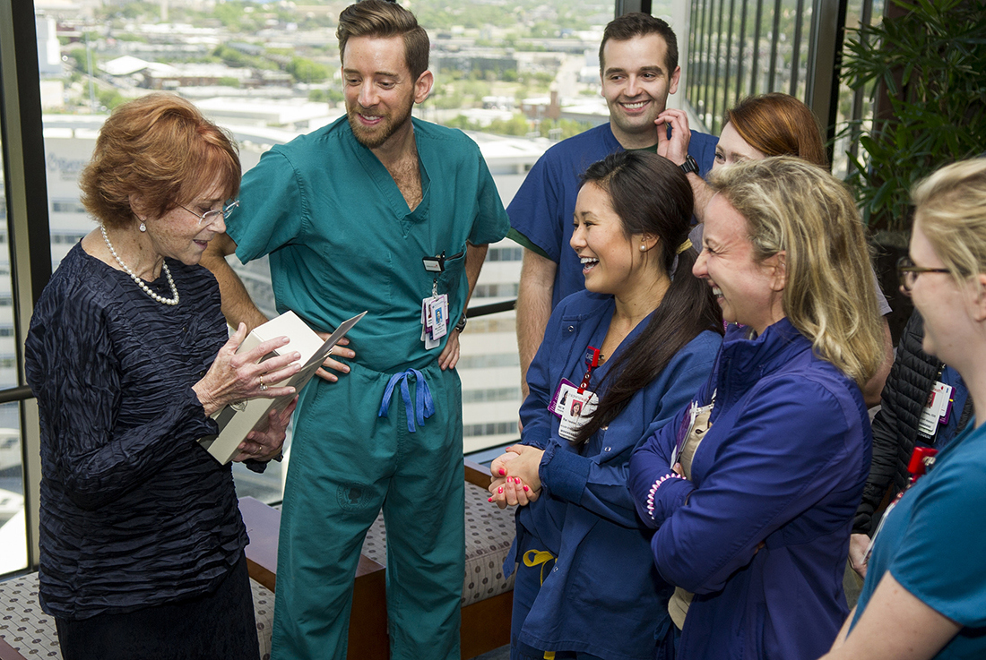 Dr. N. Sue Seale talks with pediatric dentistry residents during her March 29 retirement reception.
