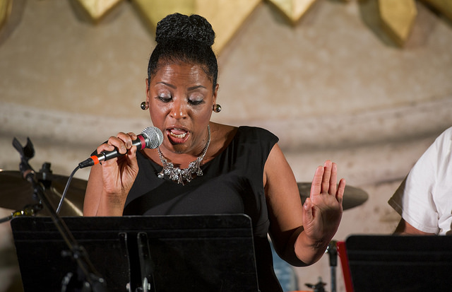 """LaDawn Brock, marketing, web and media relations manager, sings """"Loco-motion"""" during the Nov. 17 Agape benefit concert."""