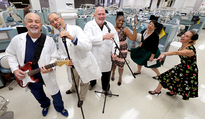 """L to R: Several members of """"Mickey & the Molars,"""" including Dr. Daniel Jones, Dean Lawrence Wolinsky, Dr. Stephen Griffin and LaDawn Brock. Also pictured: Stephanie Bohan, executive director of Agape Clinic and Barbie Lane-Wetterauer, family nurse practitioner"""